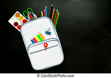 Creative school bag made of paper with school stationery on...