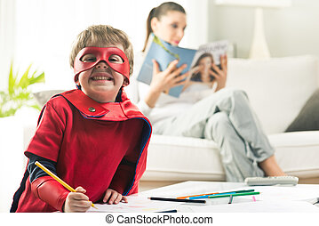 Creative superhero - Cute superhero boy drawing with mother...
