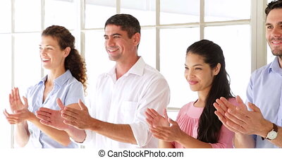 Creative team applauding in the office