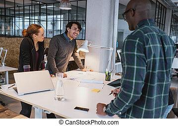 Creative team at meeting