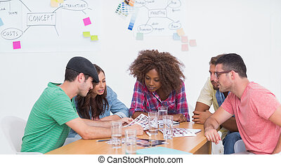 Creative team brainstorming over co
