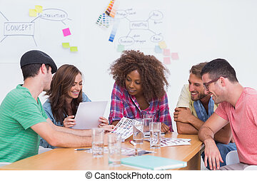 Creative team going over contact sheets in meeting