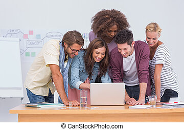 Creative team looking at laptop