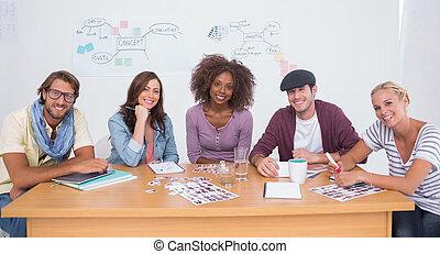 Creative team smiling at camera