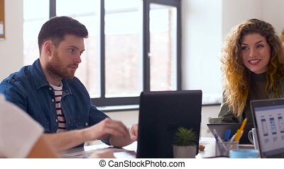 creative team with computers working at office