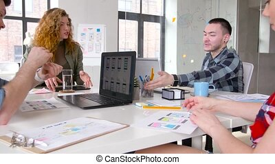 creative team working on user interface at office -...