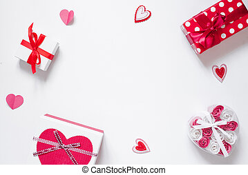Frame of romantic decor, gifts, roses, hearts on a white background with copying space.