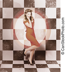 Creative vintage pin-up girl in 50s retro diner