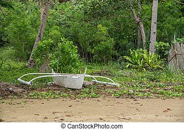 Creative white boat on the beach