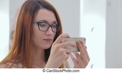 Creative woman trying to take photo. Technology concept
