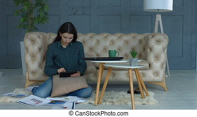 Creative woman with tablet pc working from home