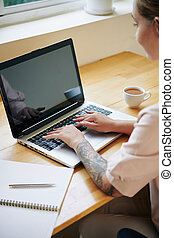Creative woman working on laptop