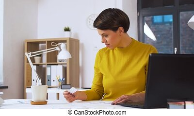 creative woman working on user interface at office -...
