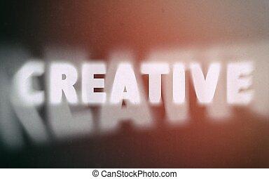 Creative word on vintage blurred background