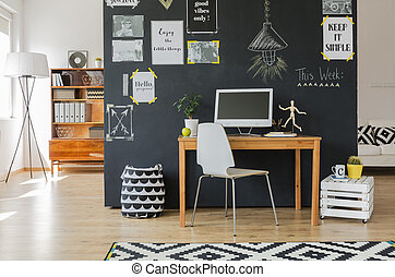 Creative working space with computer desk and accessories in...