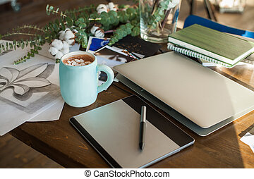 Creative Workplace Background with Drawing, Laptop and Coffee Cup