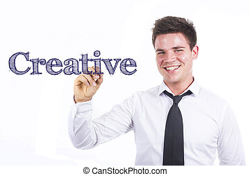 Creative - Young smiling businessman writing on transparent surface