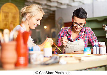 Creative Young Women Painting Together