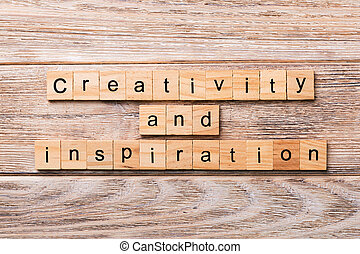 creativity and inspiration word written on wood block. creativity and inspiration text on wooden table for your desing, concept