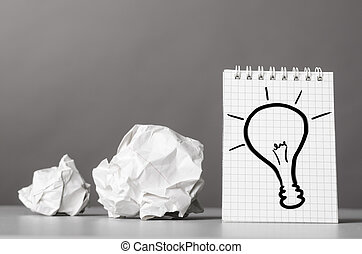 creativity - creative process. crumpled wads and notebook ...