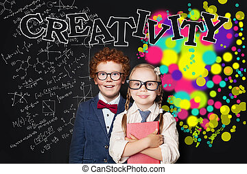 Creativity education and left hemispheres of the brain concept. Cute smart girl and boy in glasses portrait