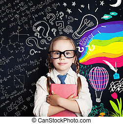 Creativity education, new ideas and right and left hemispheres of the brain concept. Smiling little girl on blackboard background with math and art pattern