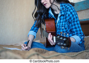 Creativity. framed portrait of a young girl playing an acoustic guitar