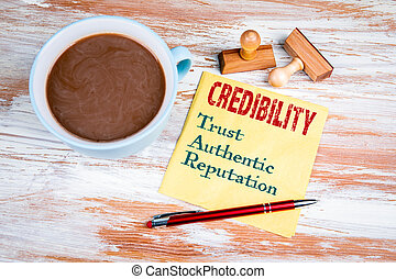 CREDIBILITY concept. Text on a napkin with a cup of coffee