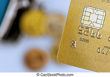 credit card and empty purse - a gold credit card and an...