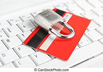 Credit Card and padlock on keyboard.