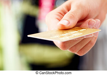 Credit card - Close-up of credit card in human hand in the...