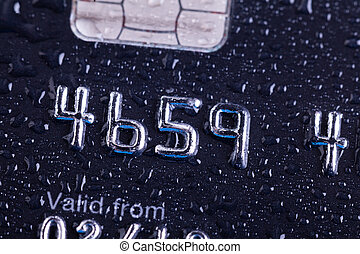 Credit card close up with water drops