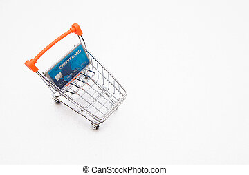 credit card in the shopping trolley on white background with copy space