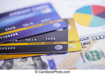 Credit card model on chart and graph paper with US dollar banknotes. Finance development, Banking Account, Statistics, Investment Analytic research data economy, Stock exchange trading, Business company concept.