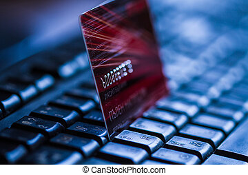 Credit card on keyboard. Online banking.