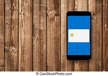 Credit card on smartphones screen - mobile wallet concept