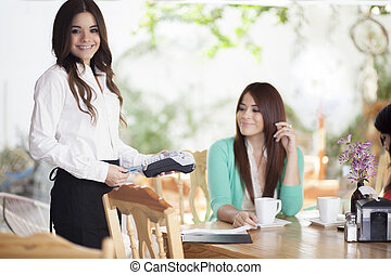 Credit card payment at coffee shop