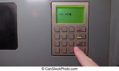 Entering pin code on an atm, first person point of view