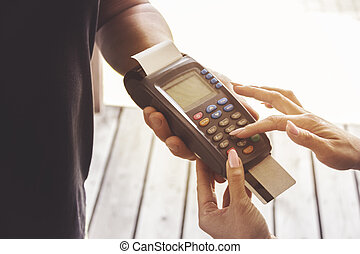 Credit card swipe through terminal for sale in store. Shopping and retail concept