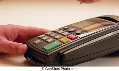 Credit card swipe through terminal machine and entering the...