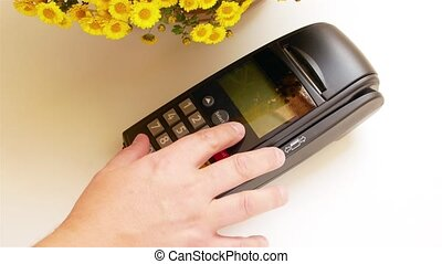 Credit card swipe through terminal machine - Payment by Gold...