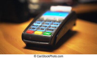Credit card terminal prints a check.