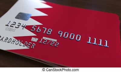 Credit card with flag of Bahrain. Bahraini banking system conceptual 3D animation