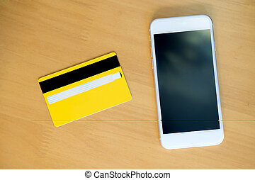 credit card with smartphone on table. View from top.