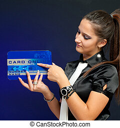 Young business woman holding and showing On line credit card