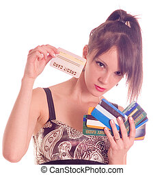 Credit card - Young woman holding credit card, numbers are...