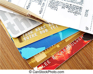 Credit cards. - Pile of credit cards with pen and receipt.