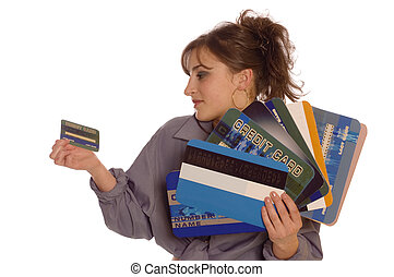 Credit cards - Young woman holding one small and a lot of ...