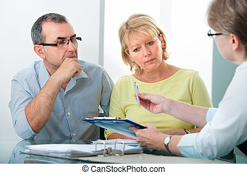 Credit counseling - Mature couple getting financial advice ...