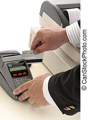 credit or bank card transaction - A salesman retailer swipes...